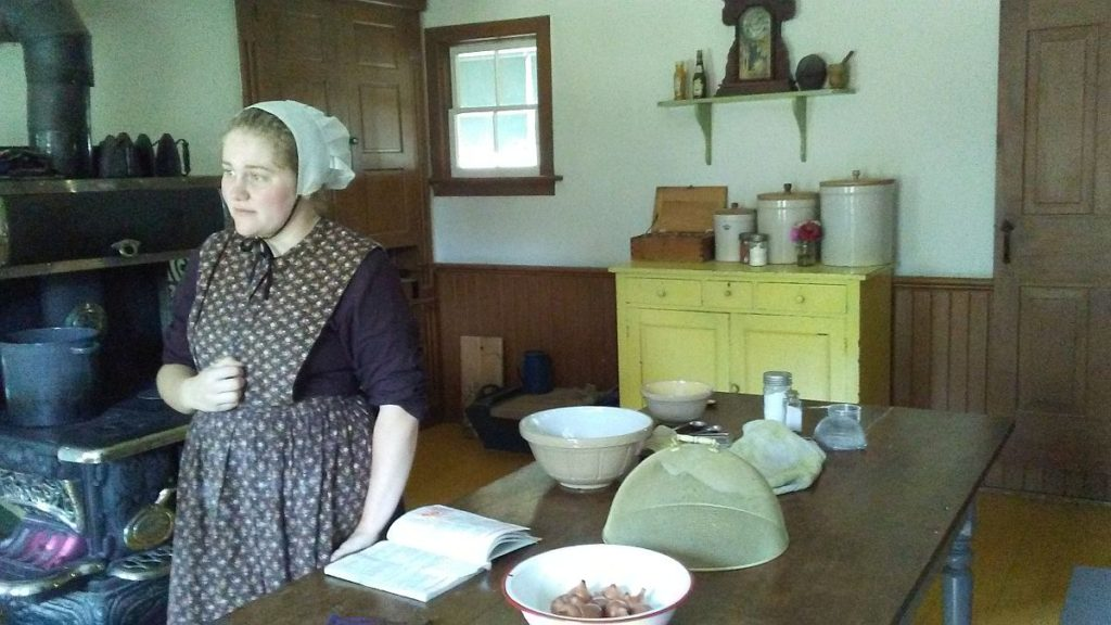 Guide, dressed in Mennonites traditional way